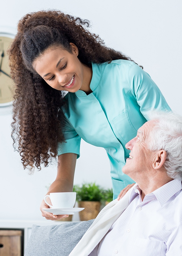 female caregiver assisting senior