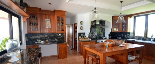 The villa has a splendid kitchen with marble tops